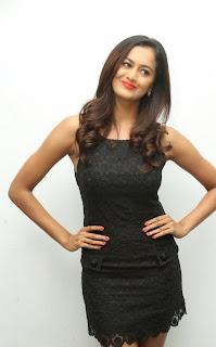 Shubra Aiyappa in Extremely Short Black Tight Sleeveless dress at Siro Makeup Hair Style Studio