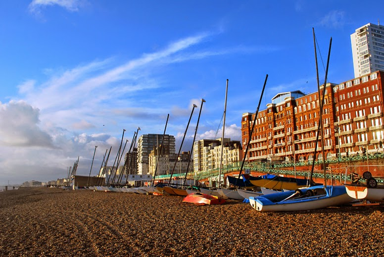 Boats along brighton beach