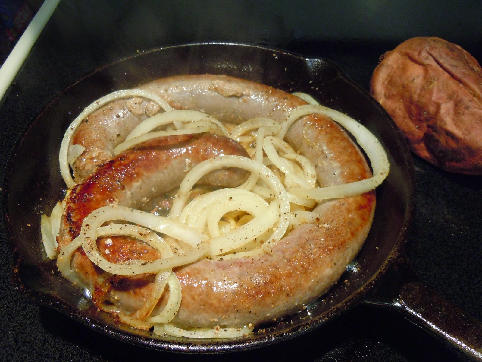 Bangers and Onions in cast iron skillet