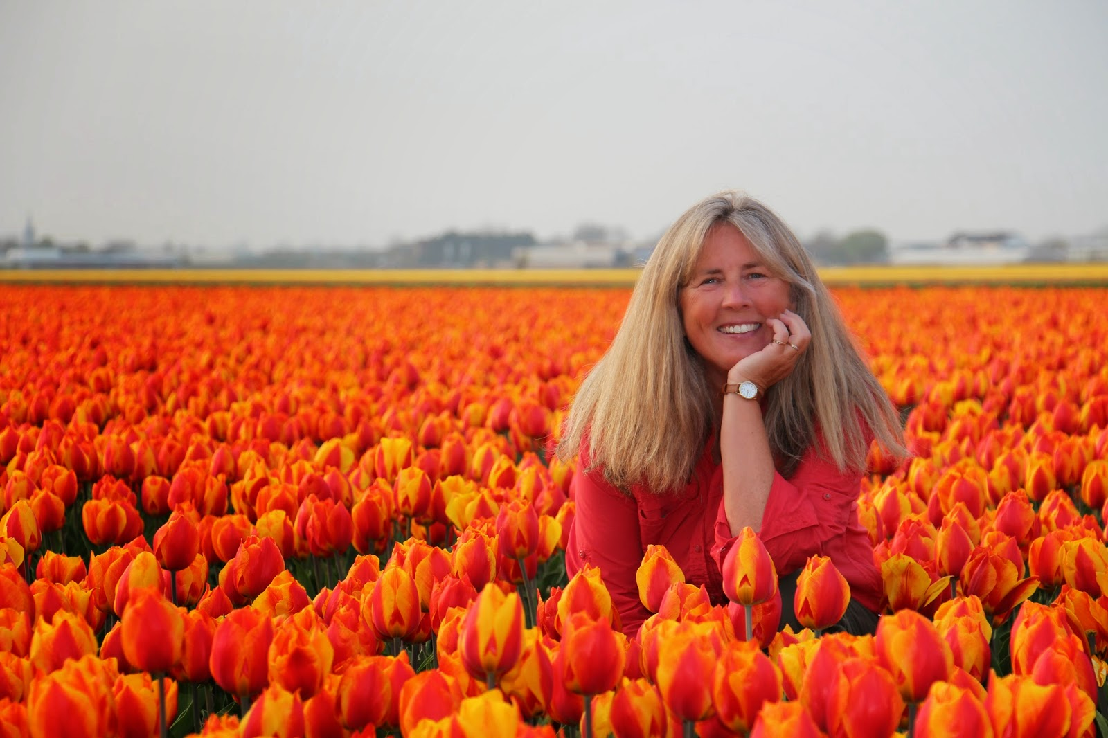 Janie in Holland tulip field.  Photograph by Janie Robinson, Travel Writer