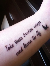 Take these broken wings and learn to fly quote tattoo with flying bird on whole arm