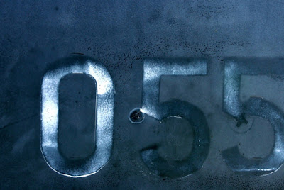 Stenciled Numbers on Dark Metal