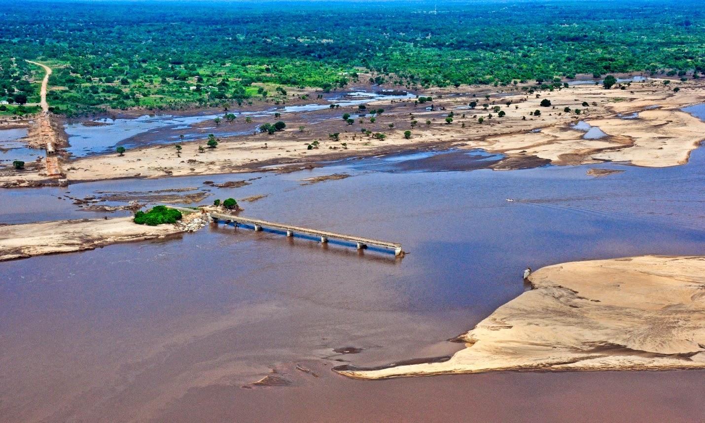 A broken bridge over the Licungo river after flooding in Zambezia province, Mozambique. (Credit: Antonio Silva/EPA) Click to Enlarge.