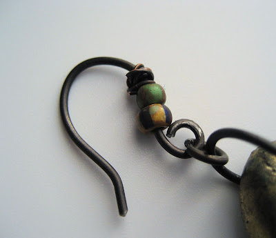 Handcrafted ear wire in darkened steel with Czech beads