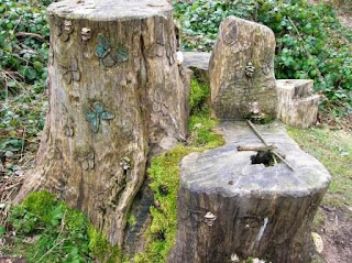 Butterfly carving on a tree stump