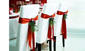 Red Ribbon with Pine Cone and Greenery Chair Cover by Happy Interiors