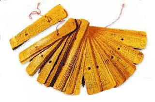 1) பூக்காமல் பூத்திருப்பான், தெரியாமல் மறைந்திருப்பான் - அது என்ன? - Palm_leaf_manuscript