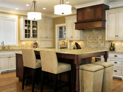 traditional style kitchen with neutral hues and contrasting dark wood finish by sweet peas design