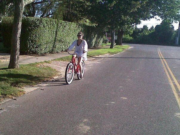 girls on bikes, riding a bike, wearing a backpack on a bike, slips ons and bikes, slip on flat shoes and cute backpacks