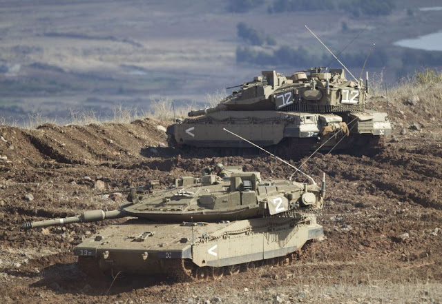 http://1.bp.blogspot.com/-FbQaiYlKiN0/UKG8vQWQWLI/AAAAAAAAUTY/E4z1aa2Mcyo/s1600/n+Israeli+tank+in+a+firing+position+in+the+Israeli-controlled+Golan+Heights+overlooking+the+Syrian+village+of+Bariqa%252C+Monday%252C+Nov.+12%252C+2012.+The+Israeli+military+says+Syrian+mobile+artillery+was+hit+after+respondin.jpg