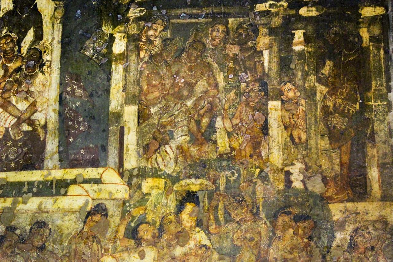 Queen Mother Maya stands musingly between 2 Pillars