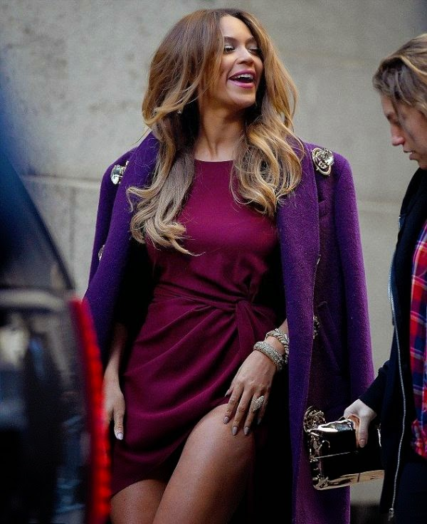Yup! This gorgeous outfit staying in tightly and alluring with a dark purple coat, plus a pair of cute high heels. . . . . .The appearance really suitable with the owner feet long at Cipriani Wal Street in New York, USA on Friday, December 12, 2014.
