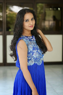Ishika Singh Pictures in Blue Dress at Hrudaya Kaleyam Movie Platinum Disc Function