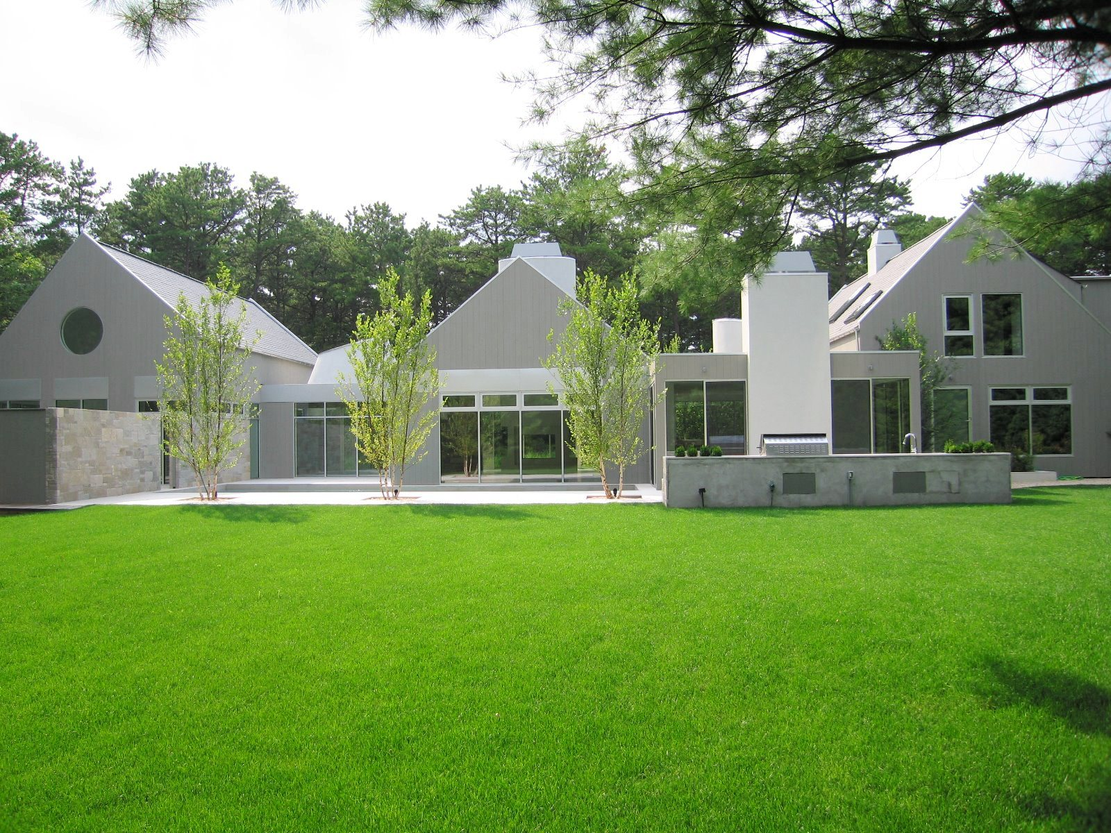 See this house white on white in a modern hamptons for Exterior design landscaping