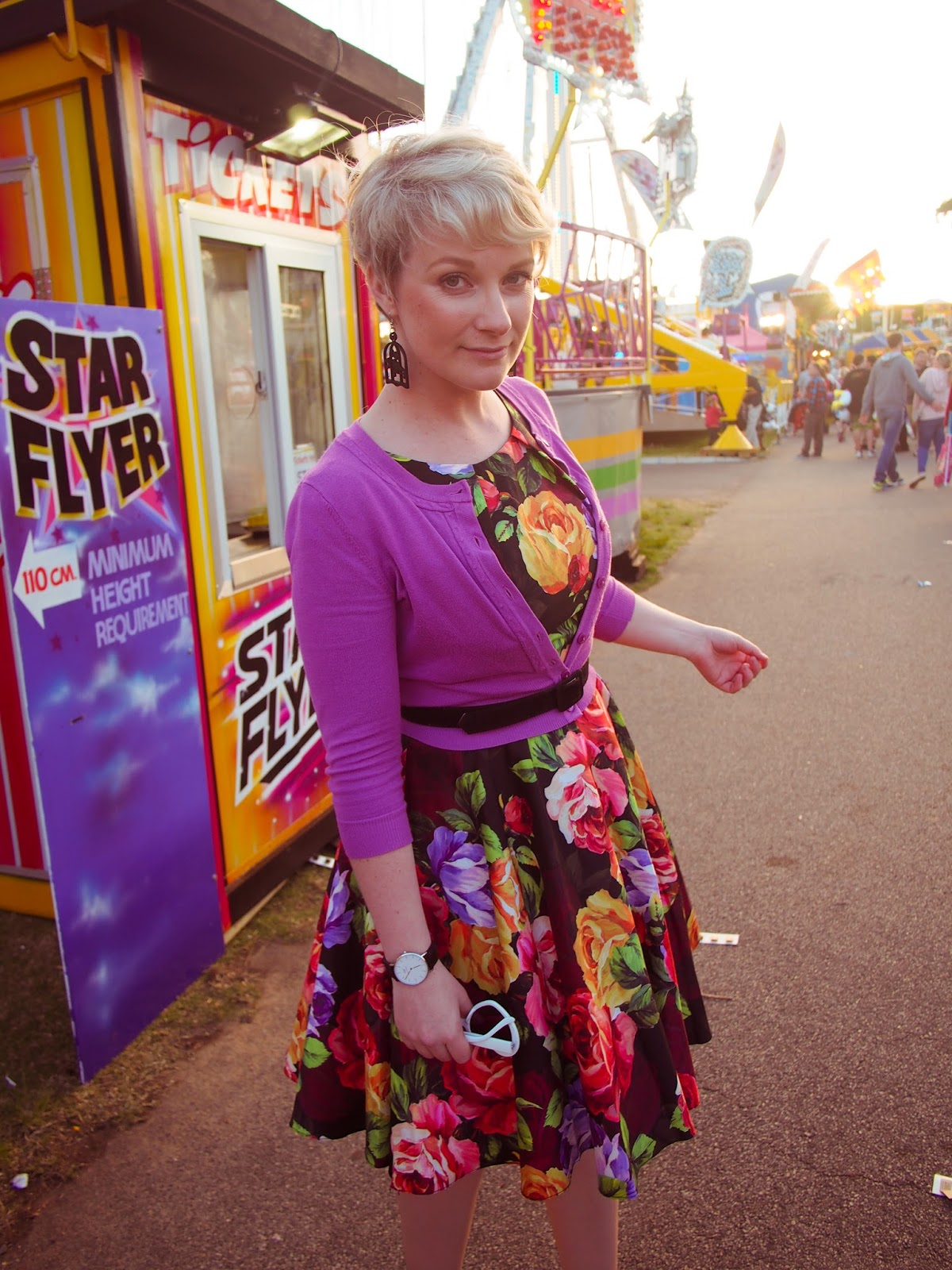 Liana of Finding Femme at the Perth Royal Show wearing Review Australia floral dress and purple cardigan with Wheels and Dollbaby belt