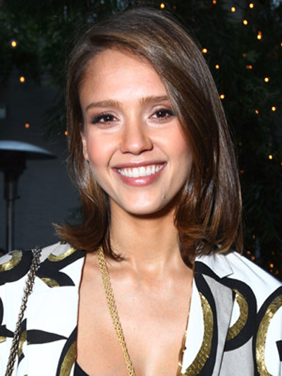 A shoulder-length hairstyle pushed to one side shows off Jessica Alba's smooth brunette locks.