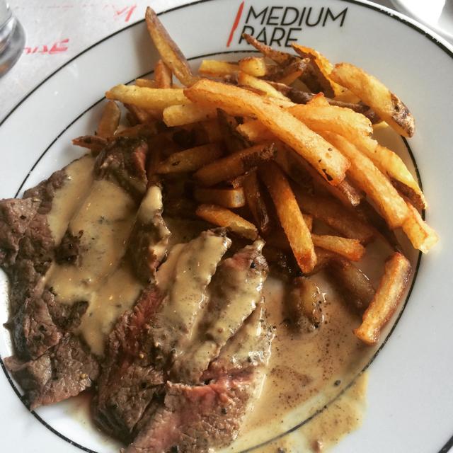 Medium rare steak with gravy
