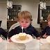 This adorable toddler tries to blow out his birthday candle in a most hilarious way