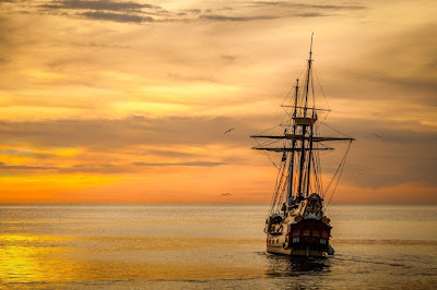 The Adventure of Life - Sailing ship at sunset