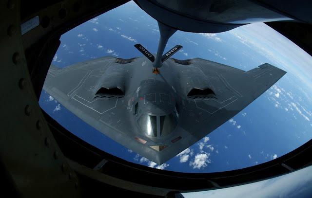 A KC-135 Stratotanker refuels a B-2 Spirit.