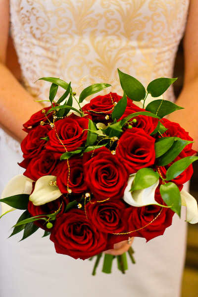 Wear Red Color Dress And Use Red Color Flower Bouquets Because Red