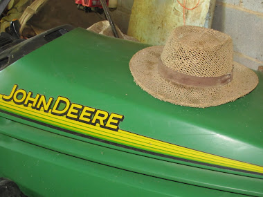 John Deere and Farmer's Hat