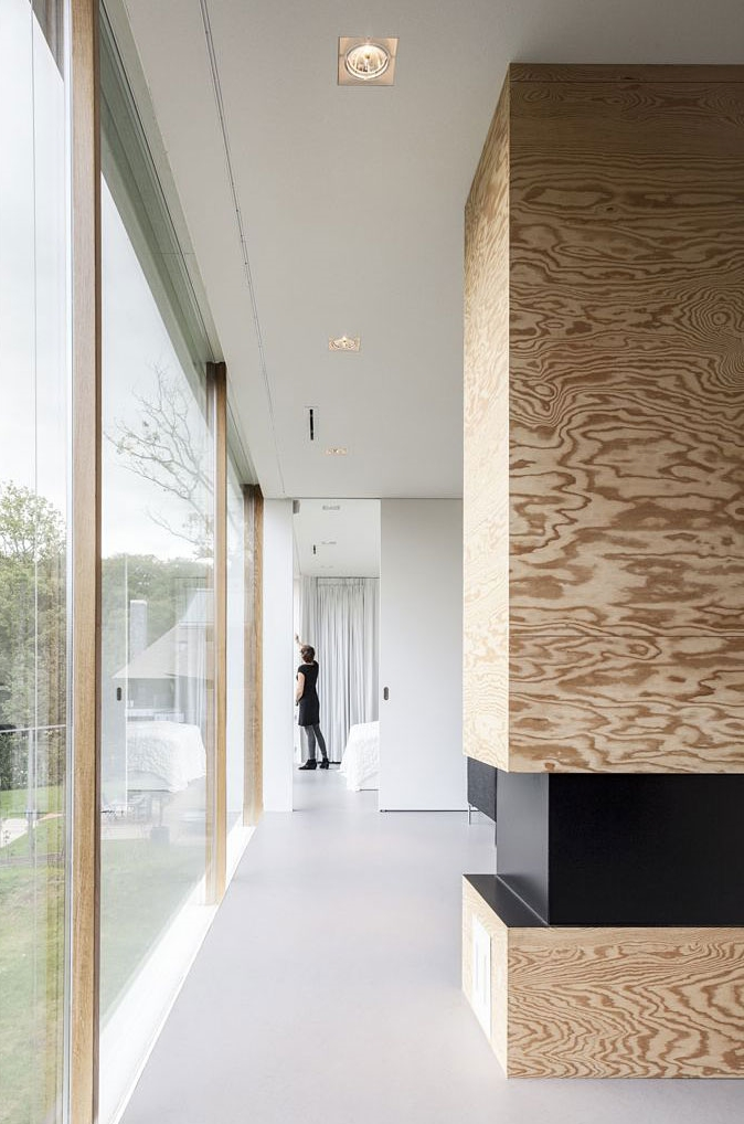 Interior and glass facade in Modern Villa V by Paul de Ruiter Architects