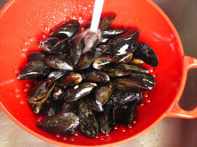 First, prepare your mussels by rinsing under cold water in a colander ...