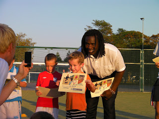 getting certificate from Linvoy Primus premiership footballer