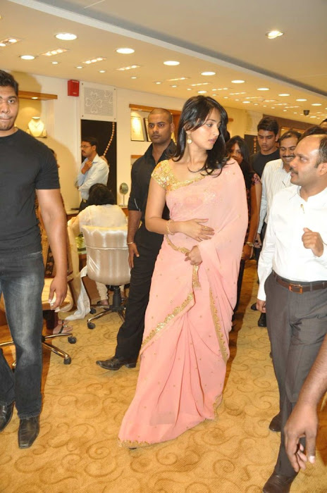 Anushka Shetty in Mustard Saree and Golden Blouse in a Shopping mall