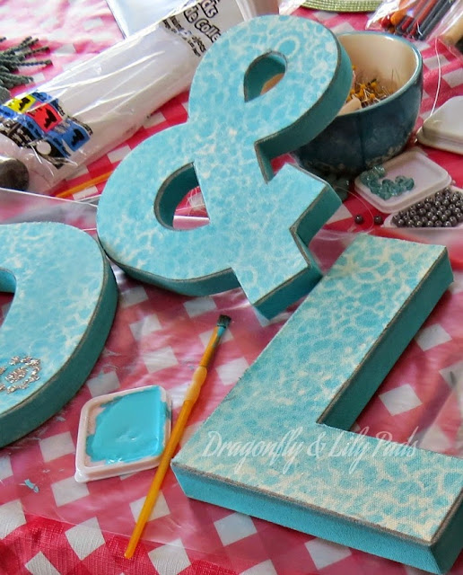 D, &, L, P, Adding Acrylic Turquoise pint to edge, Sharpie Marker Silver Metallic used to edge front of letters.