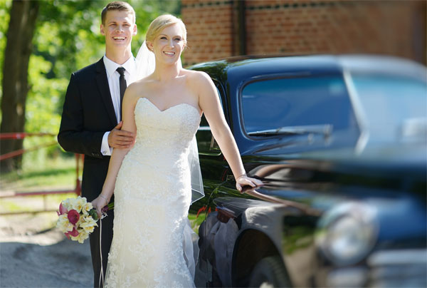 couple with wedding car