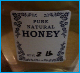 bottle of honey with a blue and white label: Pure Natural Honey, Net wt. 2 lb