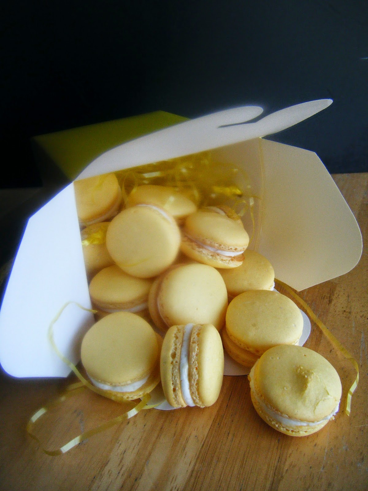 lemon macarons filled with lemon buttercream and lemon curd