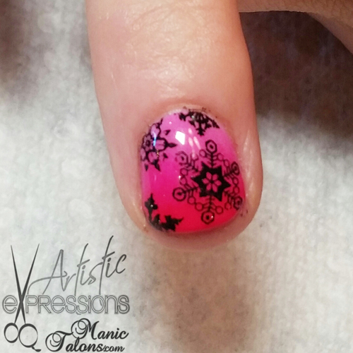 Black stamped snowflakes on a pink gradient