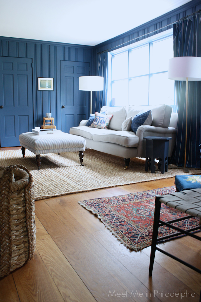 Antique rug in dark blue den via Meet Me in Philadelphia