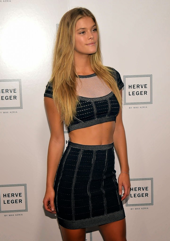 Nina Agdal in a cropped top and high-waisted skirt at the Herve Leger New York Fashion Week Show