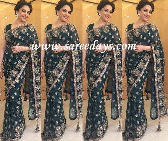 Latest saree designs madhuri dixit in green manish malhotra saree checkout madhuri dixit in green manish malhotra saree with gold work and gold work border and paired with matching short sleeves blouse altavistaventures Images