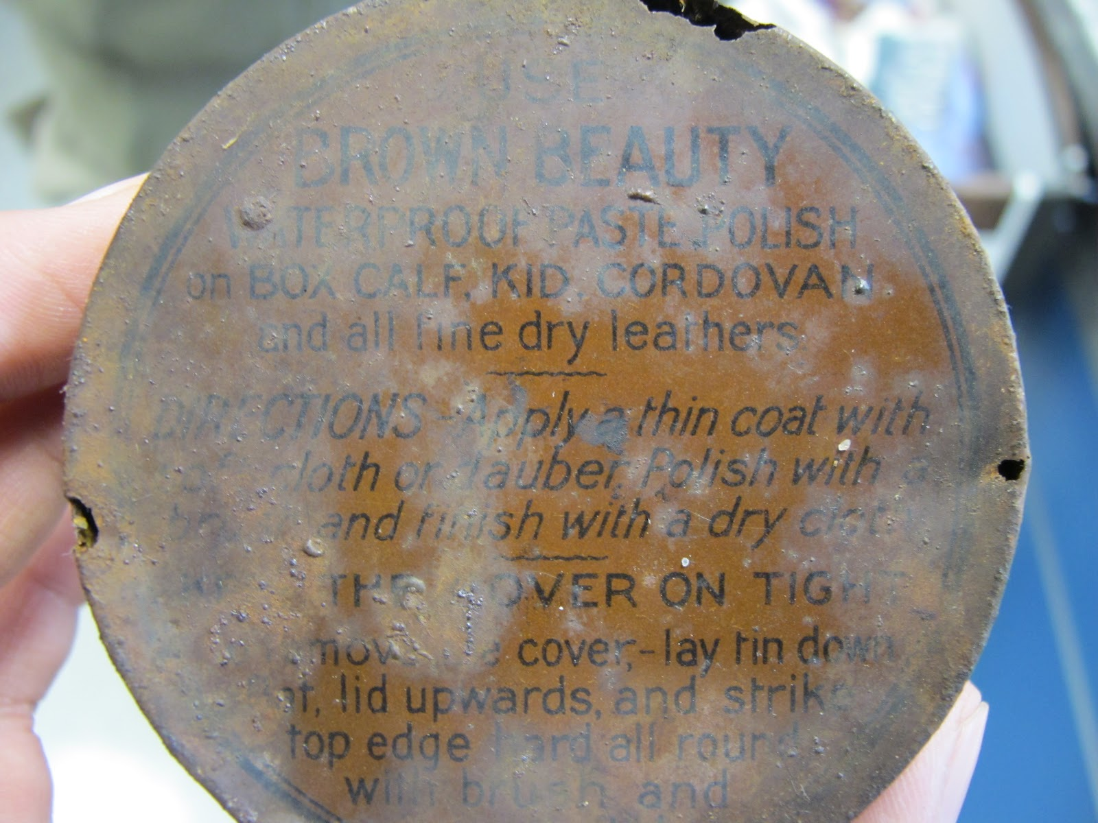text found on artifacts such as this shoe polish tin lid can help us build a timeline for the