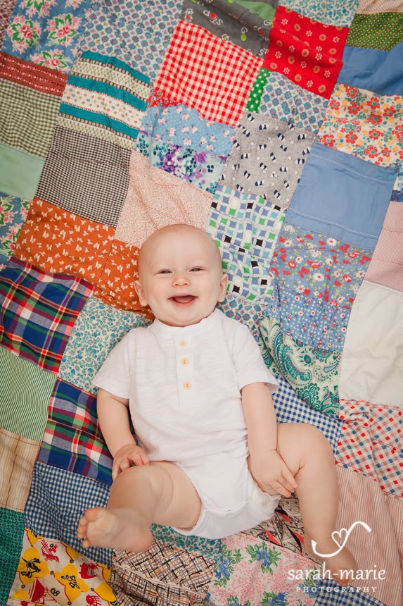 6 month old portraits on vintage quilt