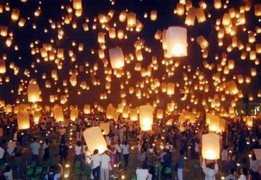 floating lanterns in the night sky