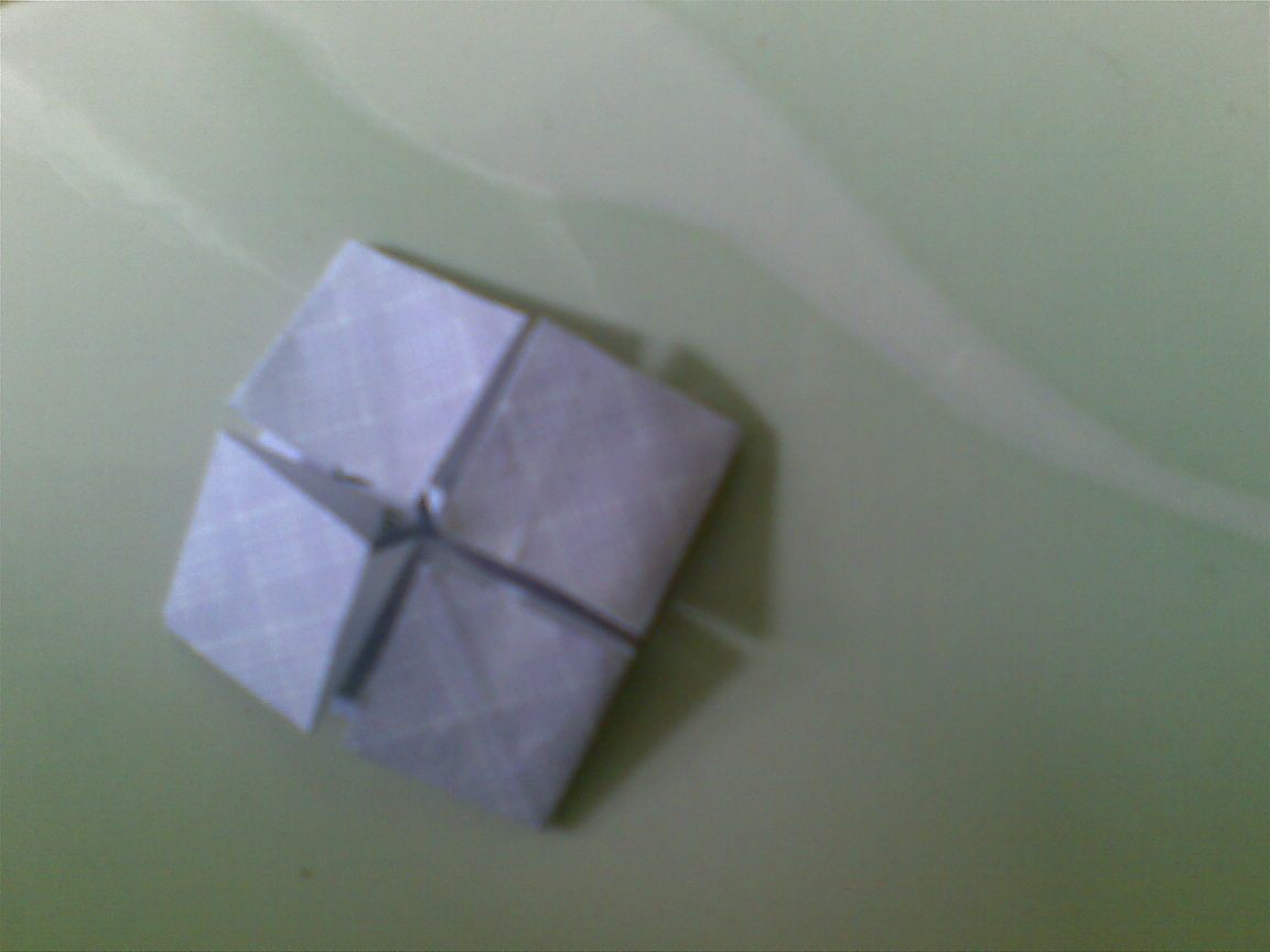 Buka lipatan segitiga