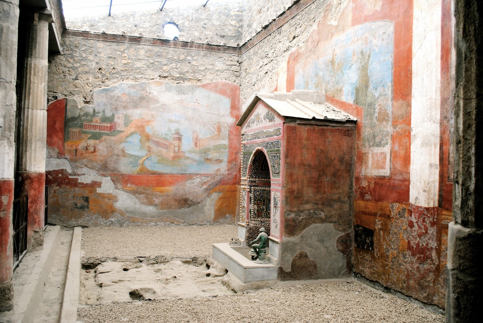 House with the small fountain in Pompeii Italy