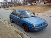 It's a 93 Mazda hatchback with a manual transmission.