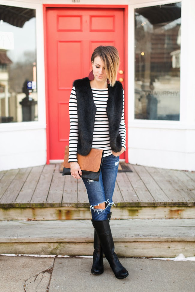 Black fur, black and white stripes and distressed denim