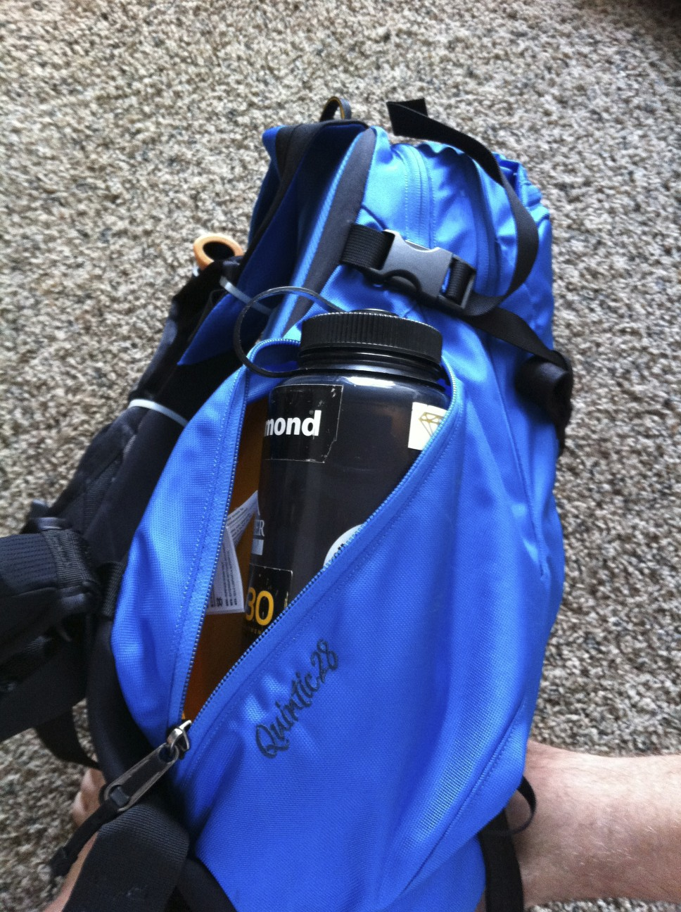 c8f727a9b3 The Arc'teryx Quintic 28. The left lower pocket of the pack is designed to  carry a water bottle. It is large enough, albeit tight, for two 1-liter  nalgenes.