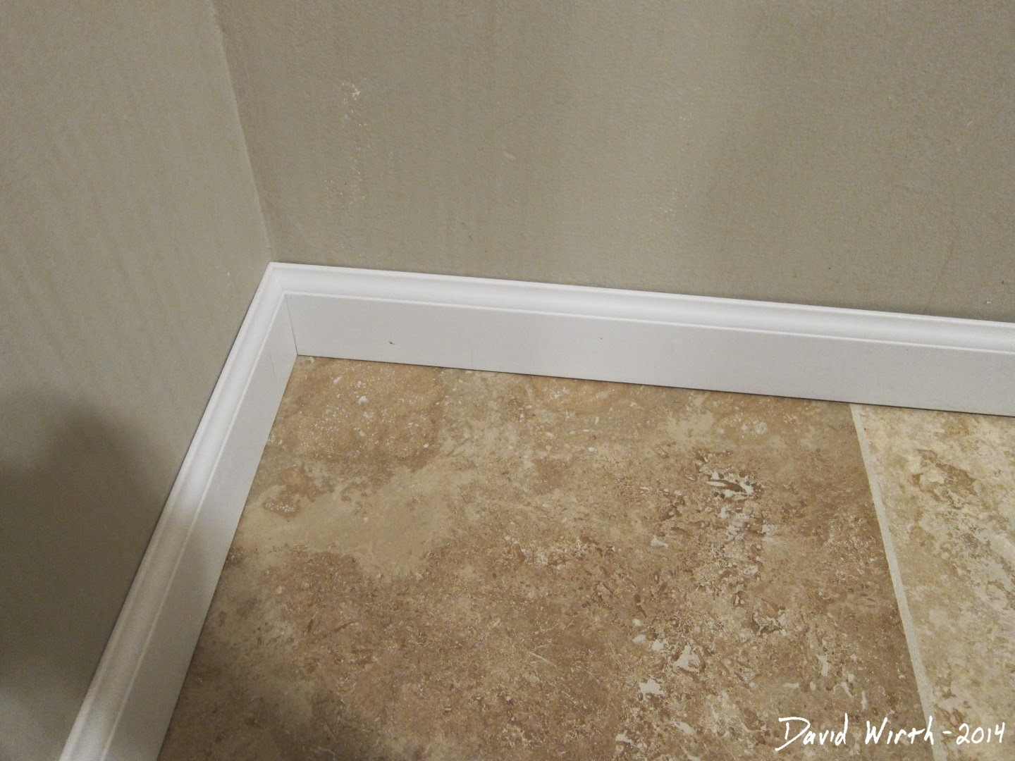 install wood baseboard, caulk