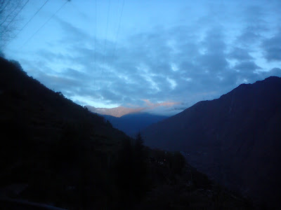 The early rays of the Himalayan sun dancing in the horizon