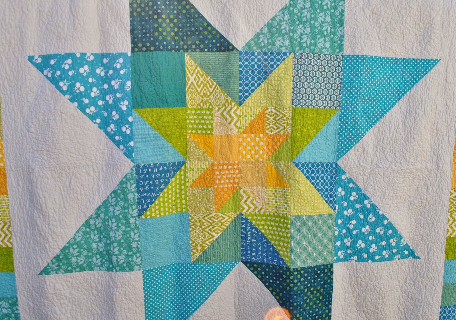 star in star wedding quilt close