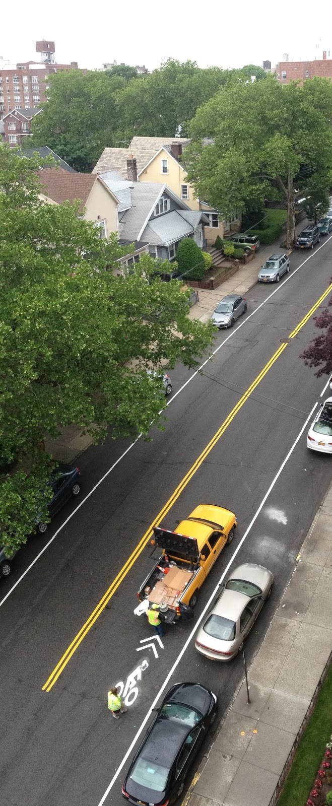 finishing touches on the bicycle route along marine avenue brooklyn